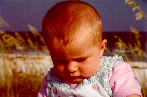 [Anna is deep in thought at Pensacola - July 2000]