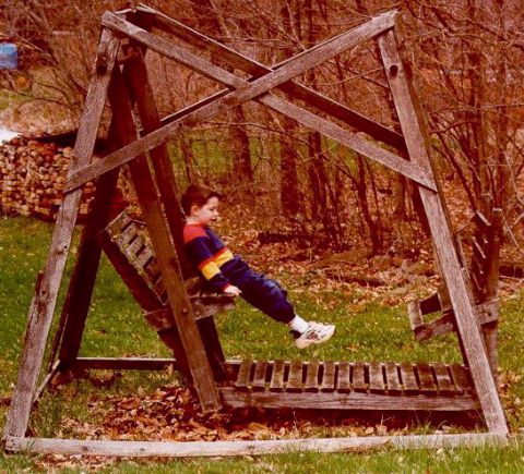[Joshua on wooden swing - Easter 2000]